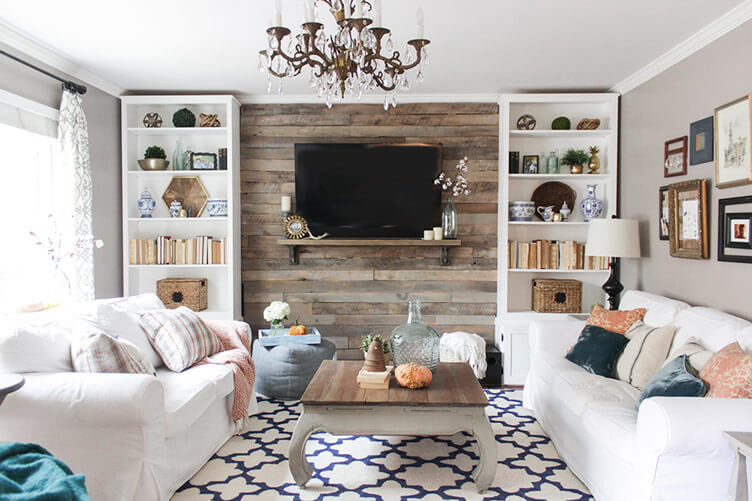 Living room with pallet wood wall behind TV