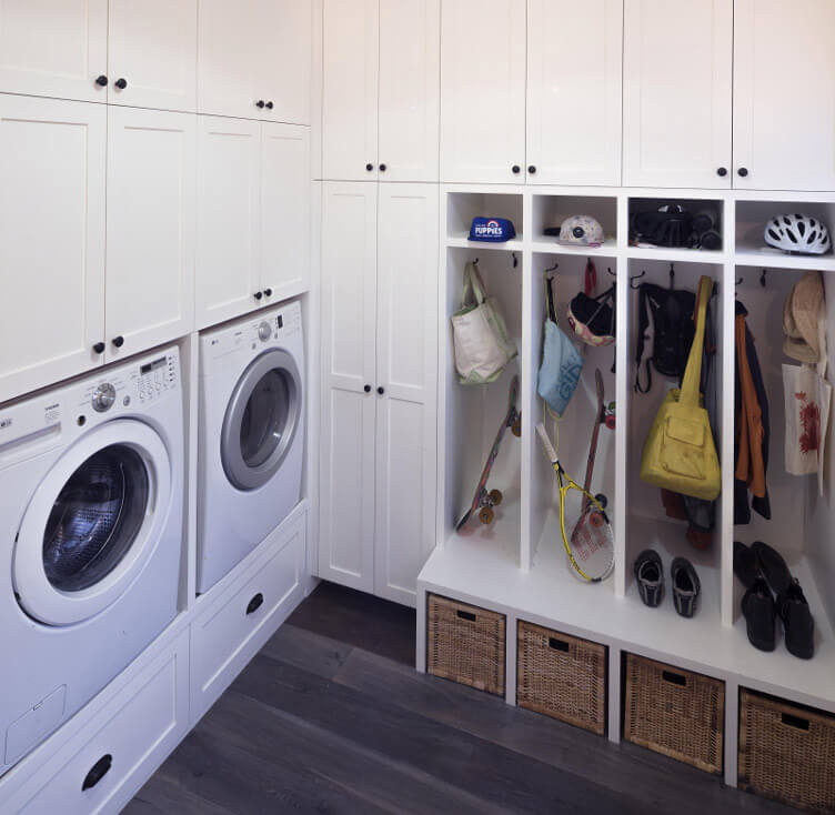 A laundry room with lots of functional storage space.