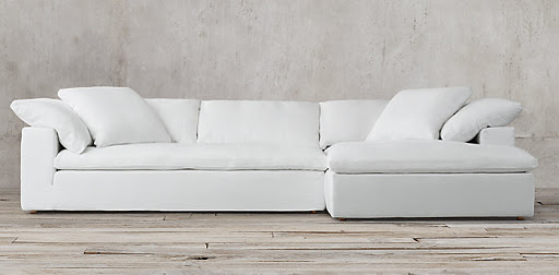 A large, white and comfy sectional