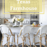 The exterior of this Texas farmhouse has a broad triangular archway over a table ready for guests!