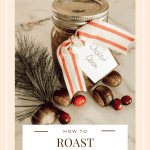 Mason jar filled with roasted chestnut creme in bow beside cranberries