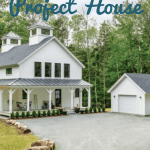 The exterior of the Project House is white with a large farmhouse porch