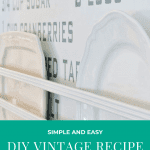 Two vintage porcelian plates on a shelf in front of the DIY recipe wall