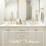 White farmhouse bathroom with white vanity and gold finishes