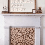Faux fireplace with wood slice insert and mirror with text
