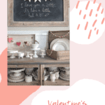 Cupboard with farmhouse style and heart banner hanging on the wall and text